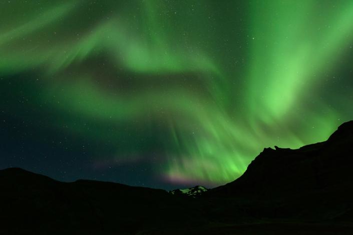 Kirkjufell sous les aurores boréales en Islande